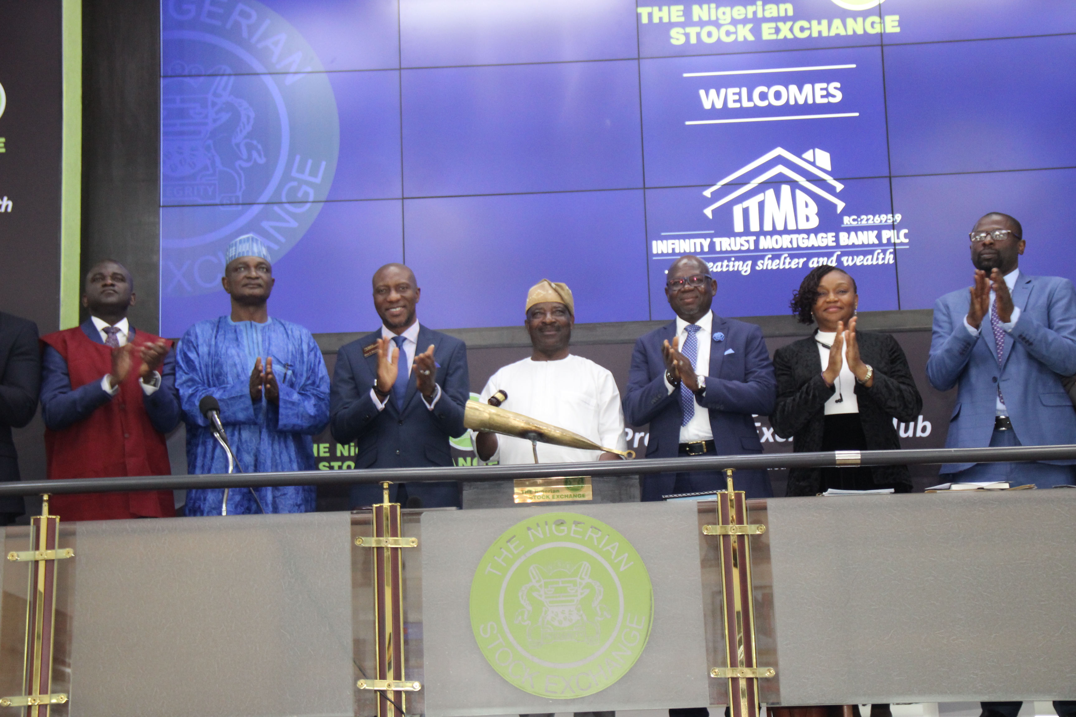 Photo News: Infinity Trust Mortgage Holds Facts-Behind-Figure, Sounds NGSE Closing Gong